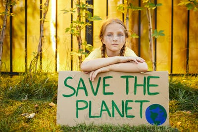 Red Haired Girl Holding Save the Planet Sign