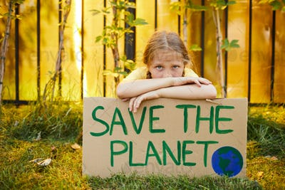 Girl Holding Save The Planet Poster