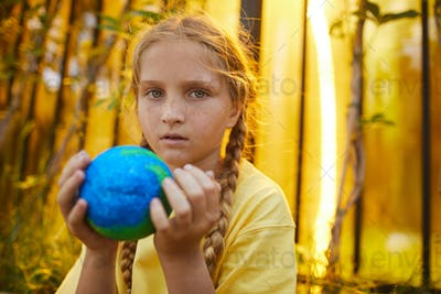 Red-Haired Girl Holding Planet