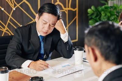 Businessman examining financial report