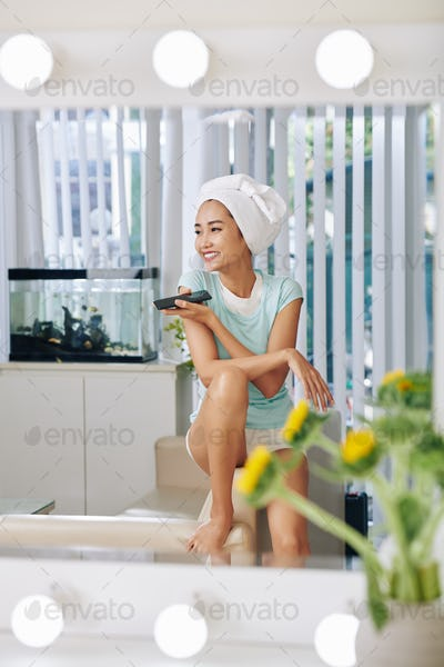 Woman listening to voice message