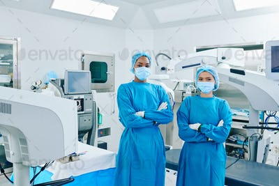 Confident young surgeon assisistants