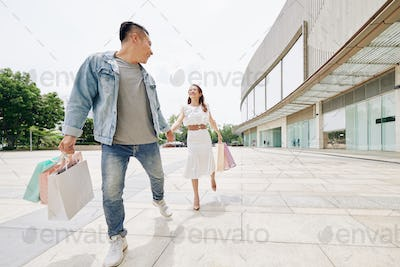 Walking couple with shopping-bags
