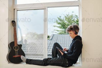 Teenage boy watching movie on tablet