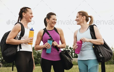 Three healthy fit young women standing chatting