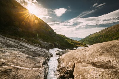 Kinsarvik, Hordaland, Norway. Water Stream Through Rocks In Hardangervidda Mountain Plateau. Sun