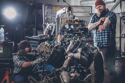 Two men in a garage.