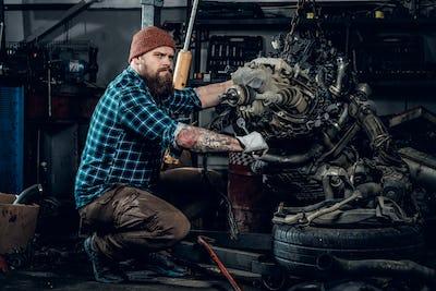 Mechanic man in a garage.