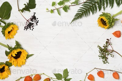 Arrangement of sunflowers and forest plants