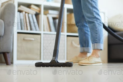 Woman vacuuming at home