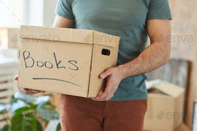 Packing books in box