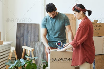 Couple packing things together