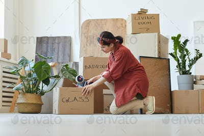 Woman moving in new apartment
