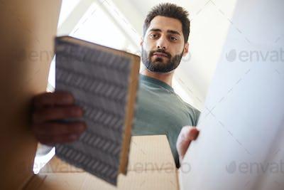 Man unpacking things