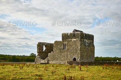 Irish celtic landscape concept. Medieval ruins of a temple build of limestone