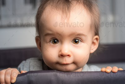 Portrait of cute one year old baby girl with big brown eyes