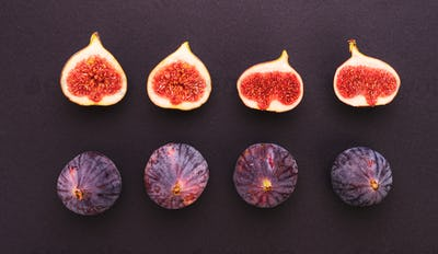 Fresh figs isolated on dark background. With halves