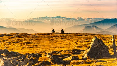 Two people enjoying view of rocky Austrian mountains from Schockl in Styria Graz