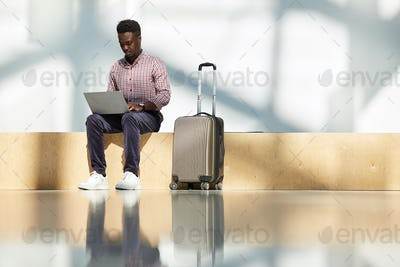 Businessman working at the airport