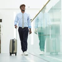 Businessman with luggage at the airport