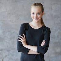 Smiling blond female in a black dress.