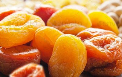 Pile of dried apricots on kitchen table. Healthy nutritious natural food