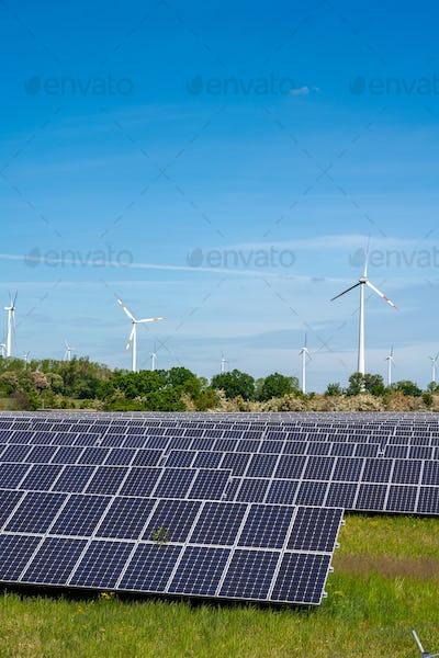 Solar power panels with wind turbines