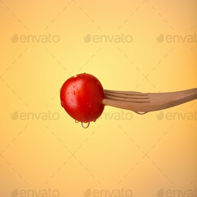 Colorful Fresh cherry tomato on fork
