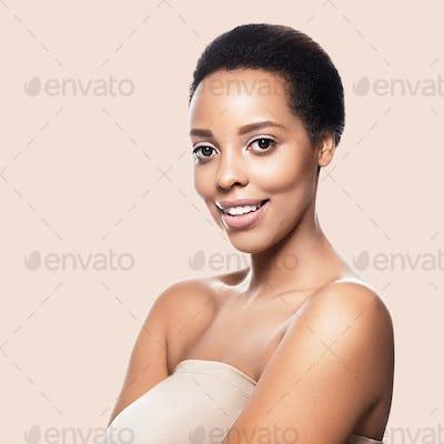 Black skin beauty woman healthy hair skin close afro american beautiful model. On beige.