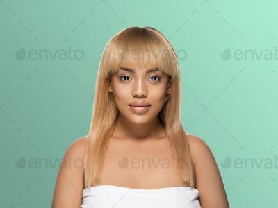 Black skin beauty woman healthy hair skin close afro american beautiful model. On blue.