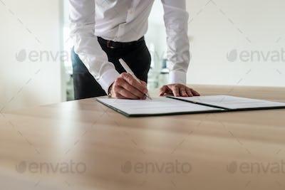 Entrepreneur signing document