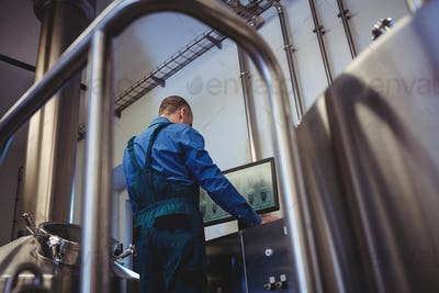Manufacturer using computer at brewery