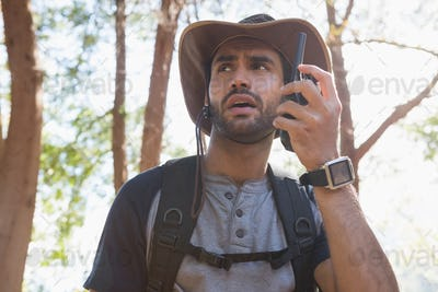 Man using walkie-talkie in the forest