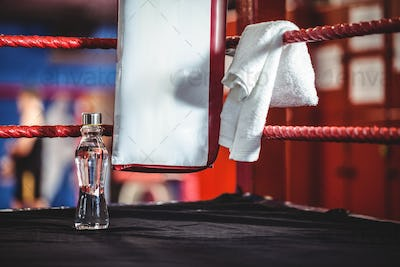 Water bottle and a towel in boxing ring