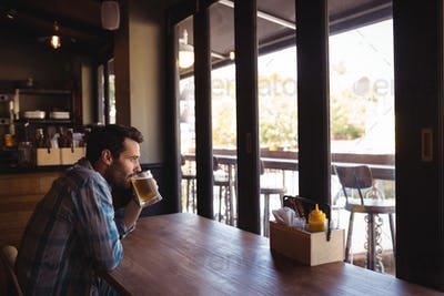 Thoughtful man having beer