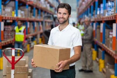 Male worker holding cardboard box