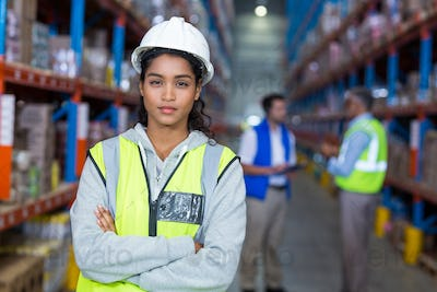Female warehouse manager standing with arms crossed