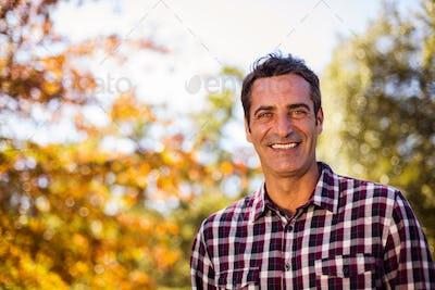 Portrait of happy man at park