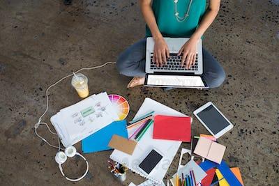 Female executive using laptop