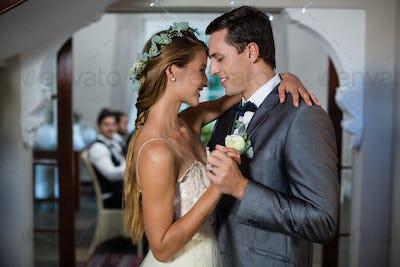 Wedding couple dancing in hall