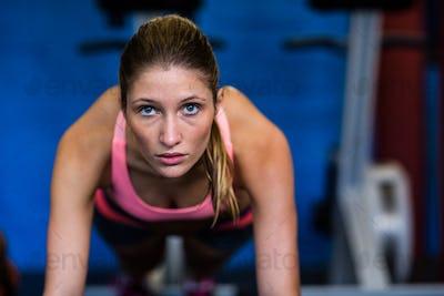 Determined female athlete doing push-ups