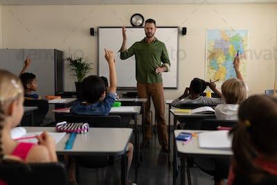 School teacher teaching in a classroom of elementary school