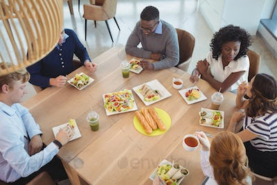 Business coworkers having breakfast at office cafeteria