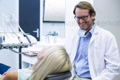 Male dentist interacting with female patient