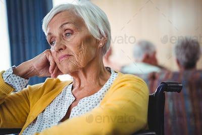Senior woman in wheelchair look worried