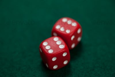 Pair of dice on poker table