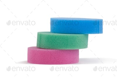 Stacked of sponge pads on white background