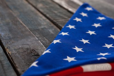 Folded American flag on wooden table