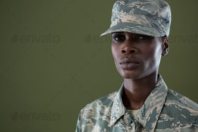 Androgynous man in camouflage uniform