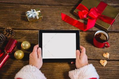 Santa Claus holding digital tablet